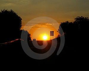 Car and sunset Stock Photos