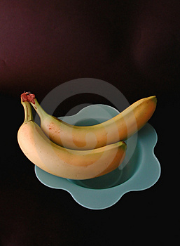 Two bananas on a blue dish Royalty Free Stock Image