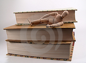 Mannequin Laying On Books Stock Photo - Image: 11130