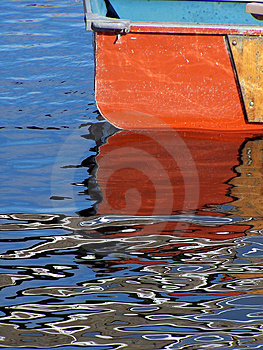 Orange Ruderboot Stockbild
