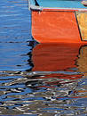 Orange rowboat Stock Image