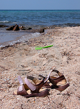 Sandals on the beach Royalty Free Stock Images