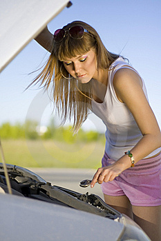 Girl Looking Under The Car Royalty Free Stock Image - Image: 10002286