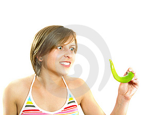Mad Girl With A Green Chilly Pepper Royalty Free Stock Photos - Image: 10002808