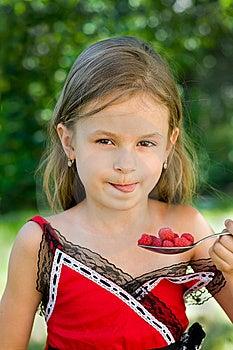 Girl Eating Raspberry Stock Image - Image: 10013151