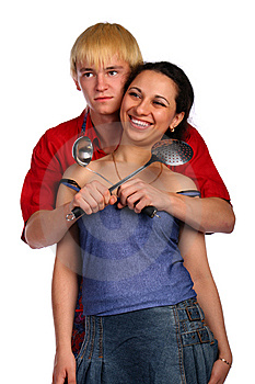 Young Man And Woman Embraces With Utensil Royalty Free Stock Photo - Image: 10016585
