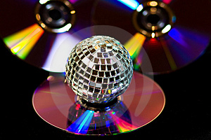Disco Ball With Music DVDS On Black Stock Image - Image: 10016751