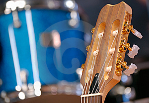Headstock Of Guitar Against Drum. Royalty Free Stock Photography - Image: 10027527
