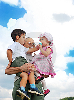 Grandmother And Kids In Her Armful Stock Photo - Image: 10028020