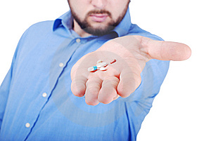 Isolated Man Offering Medical Pills Stock Image - Image: 10028101