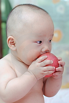 Cute Baby Eat Apple Stock Images - Image: 10034554