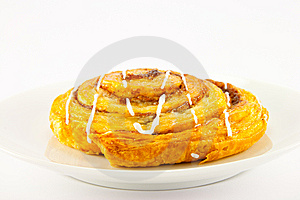 Cinnamon Bun On A White Plate Stock Image - Image: 10043281