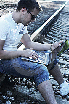 With Laptop On Rails Royalty Free Stock Photos - Image: 10045758