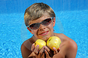 Smiling Boy With Sun Glasses Presenting Apples Royalty Free Stock Image - Image: 10059396