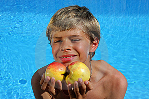 Smiling Boy Presenting Apples At Swimming Pool Royalty Free Stock Photography - Image: 10059457