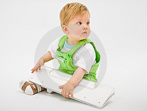 Baby With White Keyboard Royalty Free Stock Photography - Image: 10074327