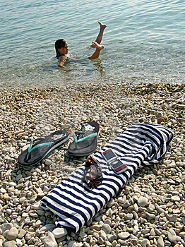 Cellular, Girl Lying On Sea Stock Images - Image: 10084054