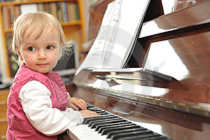 Girl Plays  Piano Stock Photo - Image: 10093080