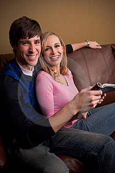 Happy Couple On The Couch Royalty Free Stock Image - Image: 10096706