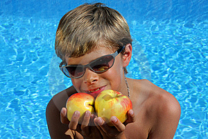 Smiling Boy With Sun Glasses Presenting Apples Royalty Free Stock Images - Image: 10104889