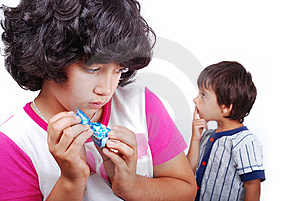 Girl Is Hiding A Present From A Boy Stock Photo - Image: 10114690