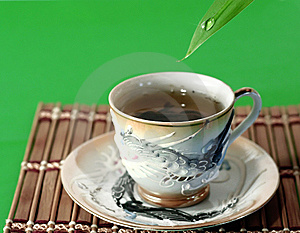 A Cup Of Green Tea And A Drop Of Water Stock Images - Image: 10138224
