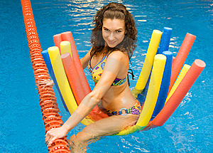 Girl In Water On Aqua Noodles Royalty Free Stock Photo - Image: 10139445