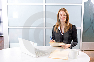 Business Woman Writing Notes At Desk Royalty Free Stock Photo - Image: 10145715