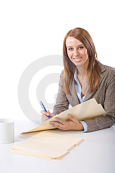 Business Woman Writing Notes At Desk Stock Image - Image: 10149301