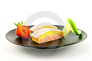 Strawberry Slices On A Black Plate Royalty Free Stock Images - Image: 10154869