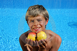 Cute And Smiling Boy Presenting Apples Stock Images - Image: 10167944