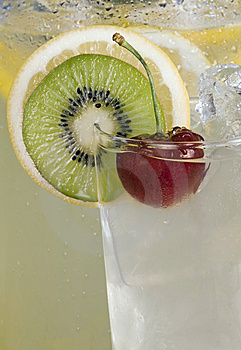 Cherry & Kiwi Garnish On Drink Stock Images - Image: 10172254