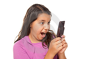 Shocked Pretty Hispanic Girl On Cell Phone Royalty Free Stock Images - Image: 10172759