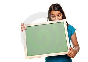 Pretty Hispanic Girl Holding Blank Chalkboard Stock Photos - Image: 10172783