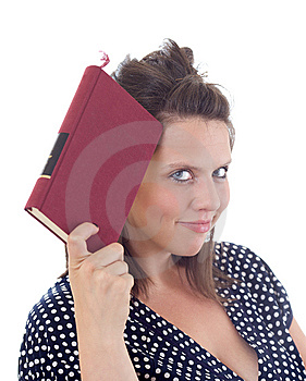 Young Woman Holding A Book To Her Head Royalty Free Stock Photography - Image: 10172977