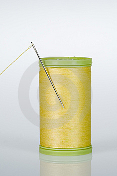 Needle And Thread - Yellow Stock Photography - Image: 10179882