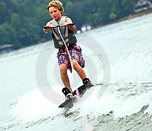 Young Boy On Trick Skis/Wake Stock Photography - Image: 10183152