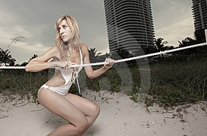 Woman Holding On To A Rope Royalty Free Stock Photography - Image: 10183567