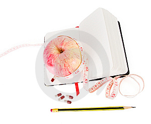 Diary With Apple And Pills For Effective Dieting Stock Image - Image: 10206421