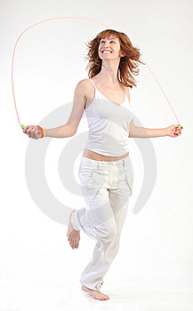 Girl Jumping With Skipping Rope Royalty Free Stock Image - Image: 10212326