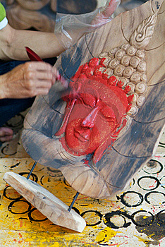 Painting A Buddha Image Stock Photo - Image: 10213700