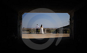 Just-married Couple In The End Of A Tunnel Royalty Free Stock Photography - Image: 10216607