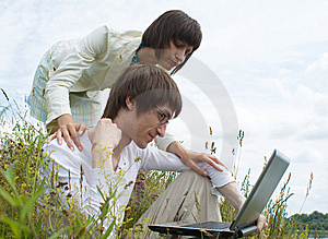 The Man And Women With Laptop Stock Photo - Image: 10217740