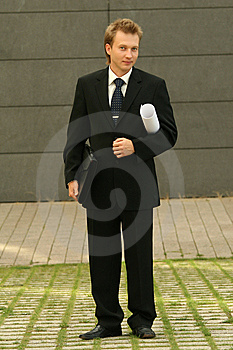 Businessman With Bag And Blueprint Royalty Free Stock Images - Image: 10219169