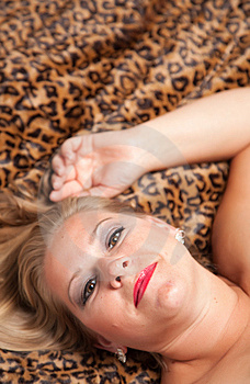Beautiful Blonde Woman Poses On Leopard Blanket. Stock Photography - Image: 10219752
