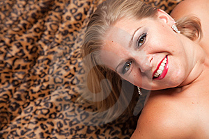 Beautiful Blonde Woman Poses On Leopard Blanket. Royalty Free Stock Photo - Image: 10219755