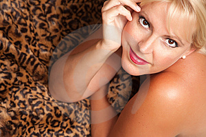 Beautiful Blonde Woman Poses On Leopard Blanket. Stock Image - Image: 10219781