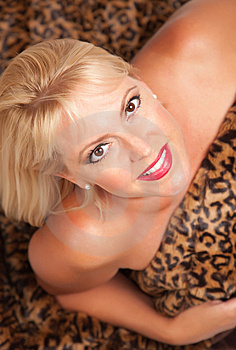 Beautiful Blonde Woman Poses On Leopard Blanket. Stock Photos - Image: 10219783