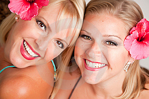 Beautiful Smiling Girls With Hibiscus Flowers Royalty Free Stock Image - Image: 10219786