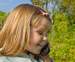 Little Girl With Phone Royalty Free Stock Photos - Image: 10225788